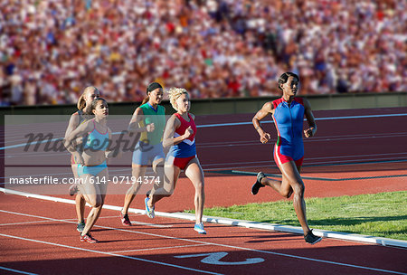 Runners racing on track Stock Photo - Premium Royalty-Free, Image code: 614-07194374