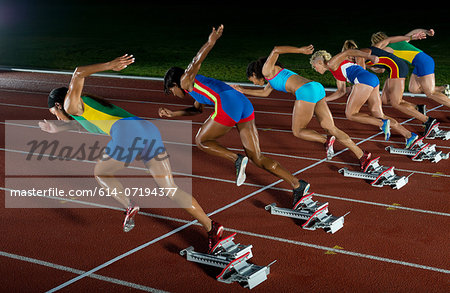 Runners starting race Stock Photo - Premium Royalty-Free, Image code: 614-07194377