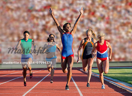 Runners at finish line Stock Photo - Premium Royalty-Free, Image code: 614-07194378