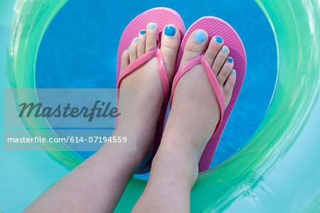 Overhead view of feet with colored nails Stock Photo - Premium Royalty-Free, Image code: 614-07194559