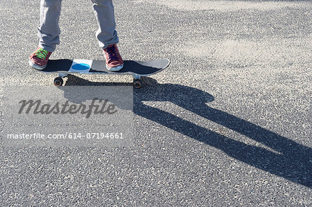 Detail of legs riding skateboard Stock Photo - Premium Royalty-Free, Image code: 614-07194661