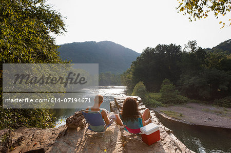 Young couple fishing on rock ledge, Hamburg, Pennsylvania, USA Stock Photo - Premium Royalty-Free, Image code: 614-07194671