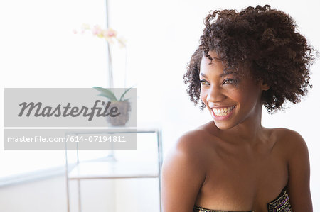 Portrait of young woman looking away Stock Photo - Premium Royalty-Free, Image code: 614-07194811