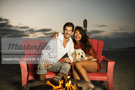 Young couple sitting by campfire on Mission Beach, San Diego, California, USA Stock Photo - Premium Royalty-Free, Image code: 614-07194845