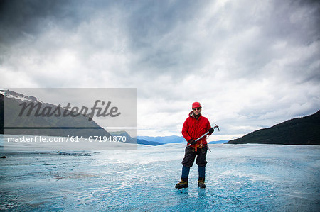 Man with ice pick on Mendenhall Glacier, Alaska, USA Stock Photo - Premium Royalty-Free, Image code: 614-07194870