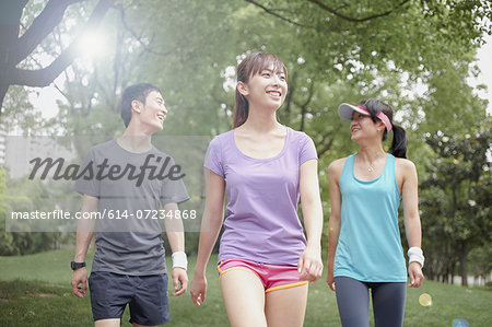 Three young joggers in park