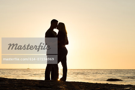 Silhouette of young couple kissing, Sunset Cliffs, San Diego, California, USA Stock Photo - Premium Royalty-Free, Image code: 614-07234969