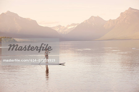 Woman on canoe, Lake McDonald, Glacier National Park, Montana, USA Stock Photo - Premium Royalty-Free, Image code: 614-07239919
