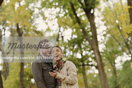 Gay couple hugging in park Stock Photo - Premium Royalty-Free, Image code: 614-07239944