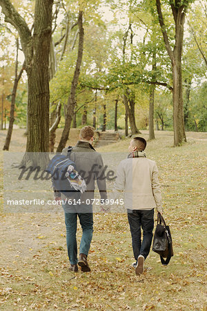 Gay couple walking in park Stock Photo - Premium Royalty-Free, Image code: 614-07239945