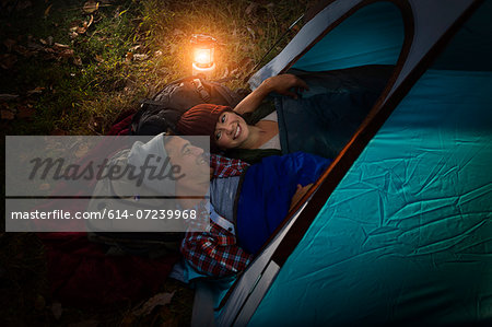 Mature couple lying together in tent Stock Photo - Premium Royalty-Free, Image code: 614-07239968