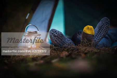 Couple lying in tent -  feet together Stock Photo - Premium Royalty-Free, Image code: 614-07239972