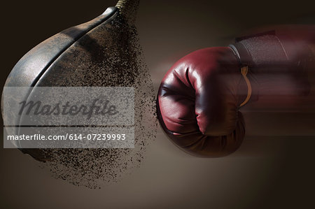 Close up boxer and punch bag with blurred motion Stock Photo - Premium Royalty-Free, Image code: 614-07239993