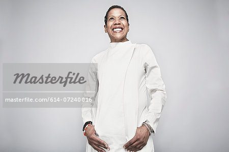 Studio portrait of mature woman with hand in pockets Stock Photo - Premium Royalty-Free, Image code: 614-07240016