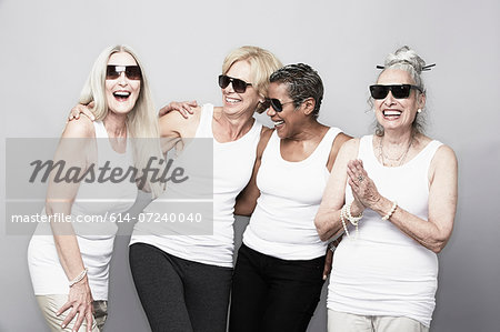 Studio portrait of senior women friends in sunglasses Stock Photo - Premium Royalty-Free, Image code: 614-07240040