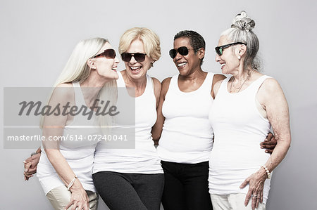 Studio portrait of senior women friends having fun Stock Photo - Premium Royalty-Free, Image code: 614-07240041