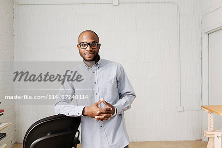 Portrait of young man in design office Stock Photo - Premium Royalty-Free, Image code: 614-07240114