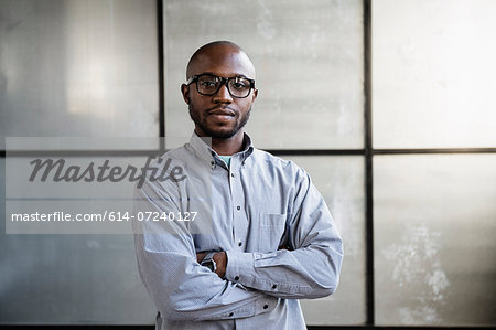Portrait of young interior designer in empty room Stock Photo - Premium Royalty-Free, Image code: 614-07240127