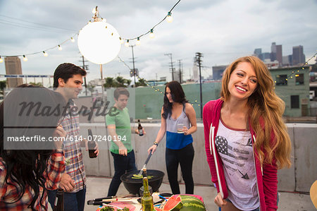 Young adult friends enjoying barbeque Stock Photo - Premium Royalty-Free, Image code: 614-07240194