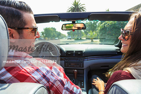 Young couple in convertible, San Diego, California, USA Stock Photo - Premium Royalty-Free, Image code: 614-07444032