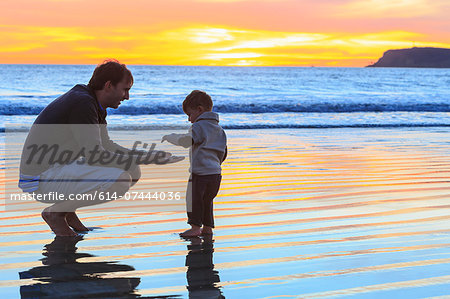 Father and toddler son playing on beach, San Diego, California, USA Stock Photo - Premium Royalty-Free, Image code: 614-07444036