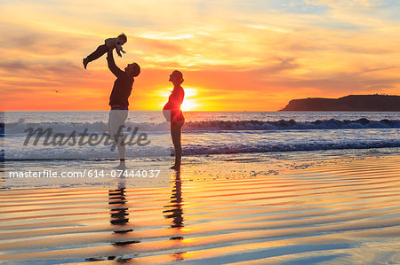 Family with toddler son playing on beach, San Diego, California, USA Stock Photo - Premium Royalty-Free, Image code: 614-07444037