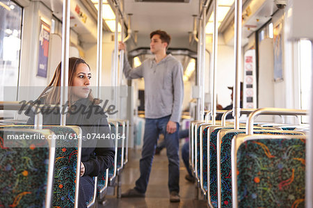 Commuters on empty subway train Stock Photo - Premium Royalty-Free, Image code: 614-07444064