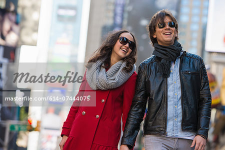 Young tourist couple holding hands, New York City, USA Stock Photo - Premium Royalty-Free, Image code: 614-07444075
