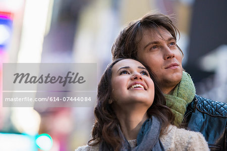 Young couple on vacation looking up, New York City, USA Stock Photo - Premium Royalty-Free, Image code: 614-07444084