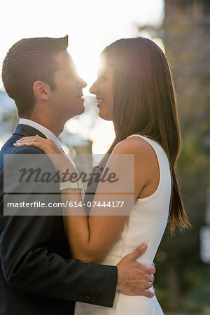Smart young couple hugging on city street, Toronto, Ontario, Canada Stock Photo - Premium Royalty-Free, Image code: 614-07444177