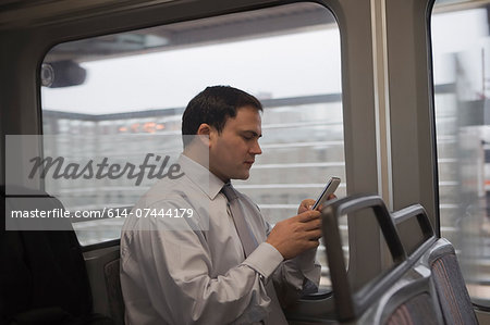 Businessman commuting to work Stock Photo - Premium Royalty-Free, Image code: 614-07444179