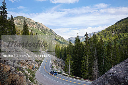 Car on winding highway, Aspen, Colorado, USA Stock Photo - Premium Royalty-Free, Image code: 614-07444377