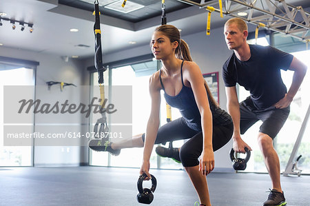 Couple working out with weights Stock Photo - Premium Royalty-Free, Image code: 614-07487101