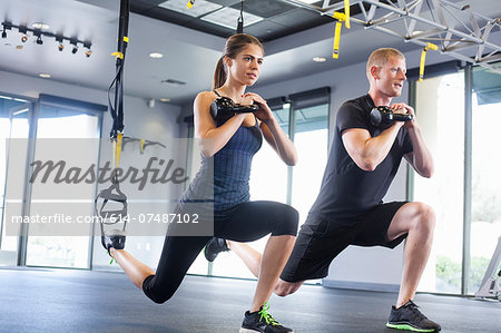 Couple working out with weights Stock Photo - Premium Royalty-Free, Image code: 614-07487102
