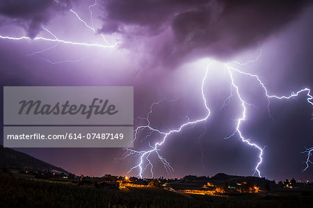 Lightning bolts over south Okanagan Valley, Penticton, British Columbia, Canada Stock Photo - Premium Royalty-Free, Image code: 614-07487149