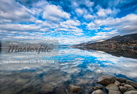 Sky reflected in Okanagan Lake, Naramata, British Columbia, Canada Stock Photo - Premium Royalty-Free, Image code: 614-07487153