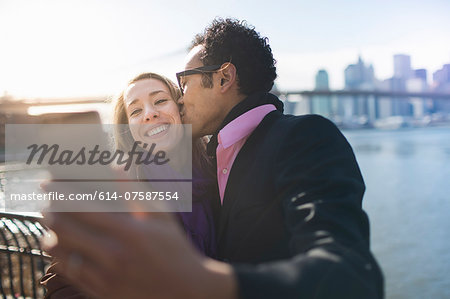 Young couple taking selfie and kissing, New York, USA Stock Photo - Premium Royalty-Free, Image code: 614-07587554