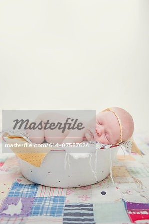 Baby lying on front in bowl Stock Photo - Premium Royalty-Free, Image code: 614-07587624