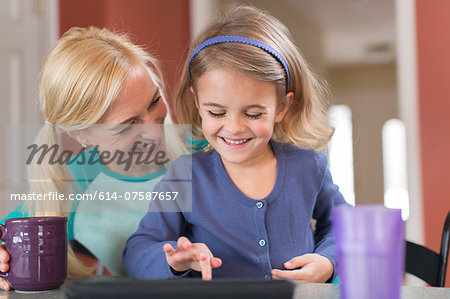 Mother and young daughter with digital tablet Stock Photo - Premium Royalty-Free, Image code: 614-07587657