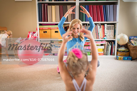 Mother and young daughter practicing ballet in sitting room Stock Photo - Premium Royalty-Free, Image code: 614-07587666