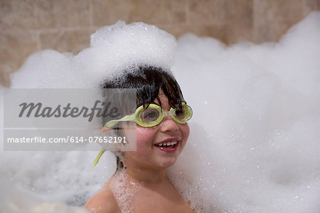 Portrait of young boy wearing goggles in bubble bath Stock Photo - Premium Royalty-Free, Image code: 614-07652191