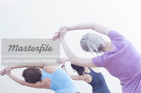 Women practising yoga Stock Photo - Premium Royalty-Free, Image code: 614-07652299