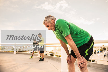 Exhausted male runners taking a break from training Stock Photo - Premium Royalty-Free, Image code: 614-07652364