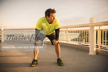 Exhausted male runner taking a break Stock Photo - Premium Royalty-Free, Image code: 614-07652365