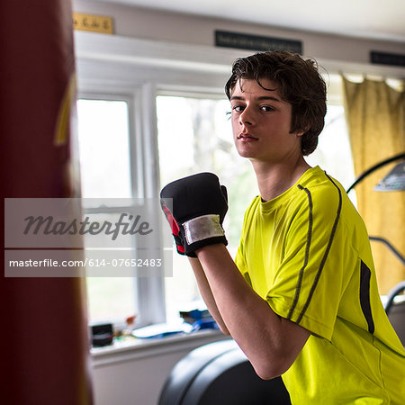 Teenage boy wearing boxing gloves Stock Photo - Premium Royalty-Free, Image code: 614-07652483