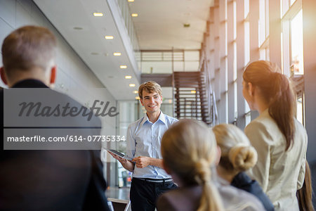 Businessmen and businesswomen at brainstorming meeting Stock Photo - Premium Royalty-Free, Image code: 614-07735334