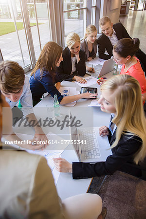 Businessmen and businesswomen at brainstorming meeting Stock Photo - Premium Royalty-Free, Image code: 614-07735341