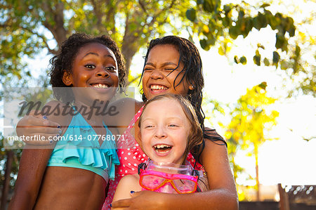 Three girls laughing in garden Stock Photo - Premium Royalty-Free, Image code: 614-07768071