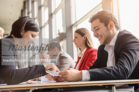 Business colleagues sharing ideas at meeting Stock Photo - Premium Royalty-Free, Image code: 614-07768127