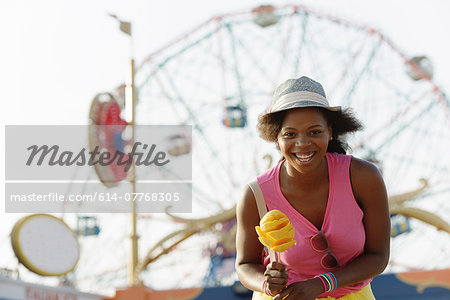 Portrait of young woman with ice cream cone, Coney Island, Brooklyn, New York, USA Stock Photo - Premium Royalty-Free, Image code: 614-07768305